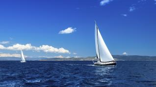 Sailboat on water with clouds