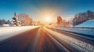 Rising sun on a winter road