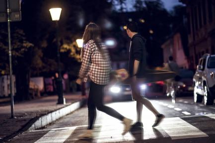 Pedestrians in crosswalk at night